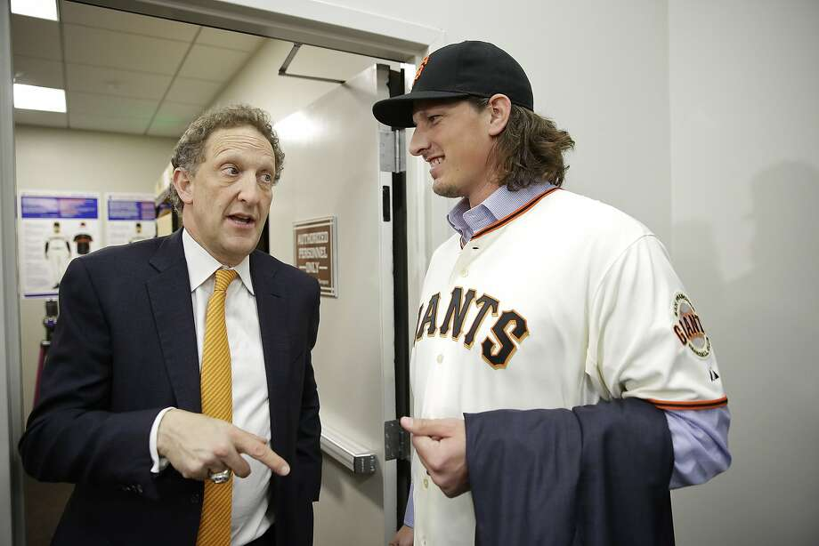 San Francisco Giants pitcher Jeff Samardzija, right, listens to team president and CEO Larry Baer, left, following a news conference Friday, Dec. 11, 2015, in San Francisco. The Giants introduced right-hander Samardzija, who signed a $90 million, five-year deal. (AP Photo/Eric Risberg) Photo: Eric Risberg, Associated Press