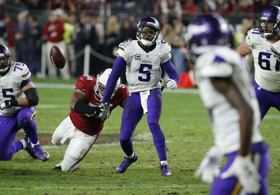 Cardinals inside linebacker Dwight Freeney forces Vikings quarterback Teddy Bridgewater to fumble near the end of regulation to win it for Arizona. Photo: Ross D. Franklin, Associated Press