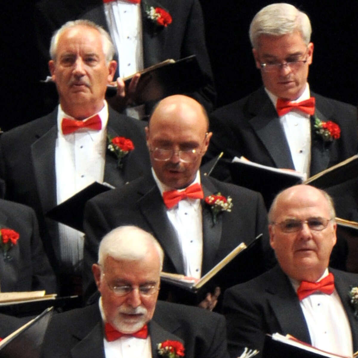 Gary Oliver, center, with shaved head, sang baritone in the Mendelssohn Club, an all-male chorus where he was a member for the past three years (Photo courtesy of the Mendelssohn Club)