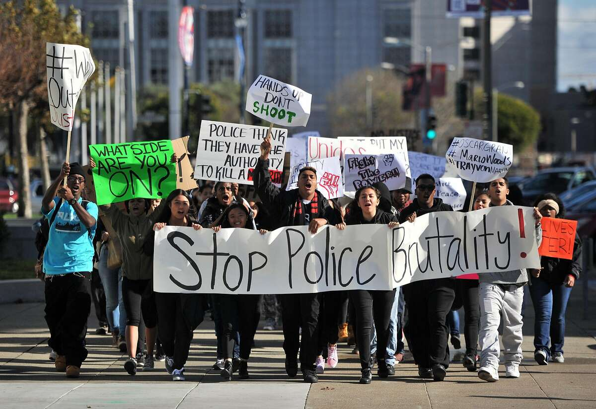 Students from several high schools express their frustration towards police as they converge on City Hall in San Francisco on Friday, December 11, 2015.