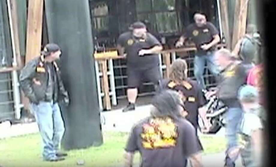 In this image made from Texas Department of Public Safety video, bikers run for cover as a shooting erupts outside a Twin Peaks restaurant in Waco, Texas, on May 17, 2015. The latest trove of potential grand jury evidence reviewed by the AP depicts a chaotic, bloody scene in which police swarmed into the shootout between rival biker gangs that left about 20 wounded and arrested nearly 200 people. Four of the nine people killed in the melee were struck with bullets from the same caliber rifles fired by Waco police, according to the evidence, which provides the most insight yet into what role authorities may have played in the deaths. (Texas Department of Public Safety via AP) Photo: Associated Press