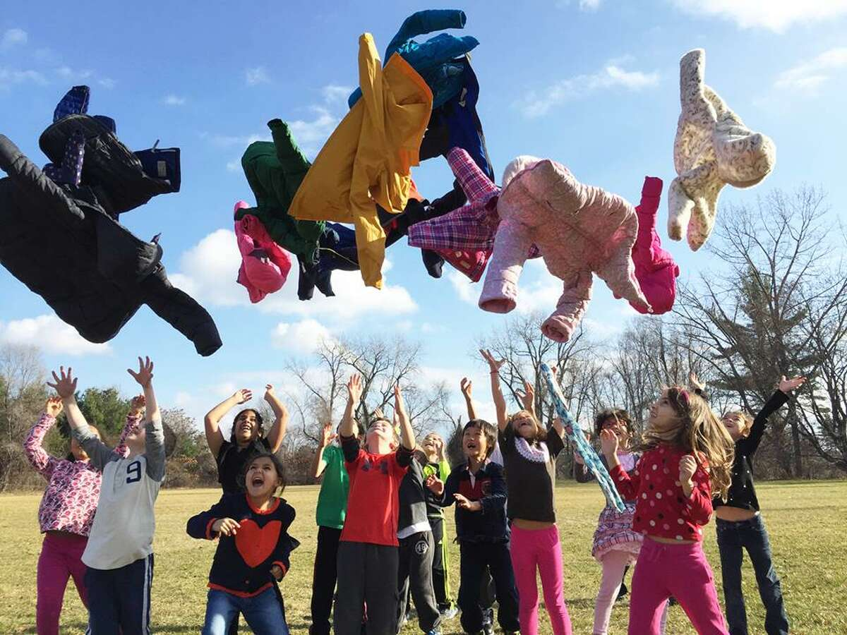 Students from Tracy Martone's first-grade class at Westmere Elementary School in Guilderland rejoice in the unseasonably warm weather Thursday. Friday was much the same, as the weekend will be. (Submitted photo)