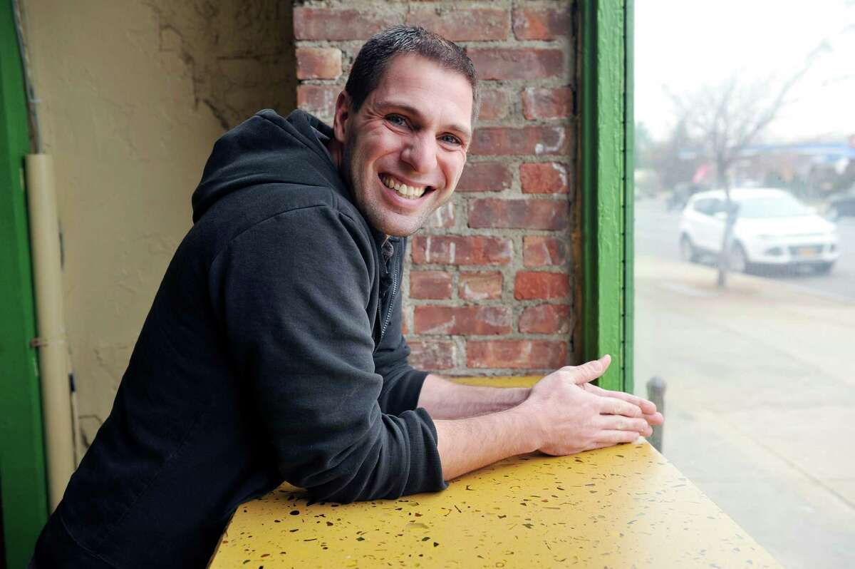 Jonathan Hentrich, lead pastor of Christ's Church Albany, poses for a photo at Tierra Coffee Roasters on Tuesday, Dec. 8, 2015, in Albany, N.Y. (Paul Buckowski / Times Union)