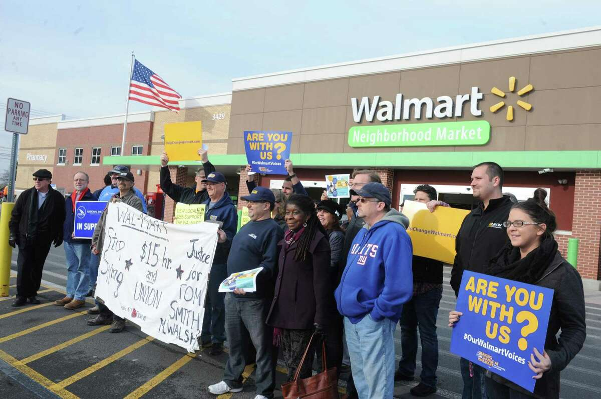 A rally led by national group, Making Change at Walmart UFCW took place in front of Walmart Neighborhood Market on Friday Dec. 11, 2015 in Niskayuna, N.Y. (Michael P. Farrell/Times Union)