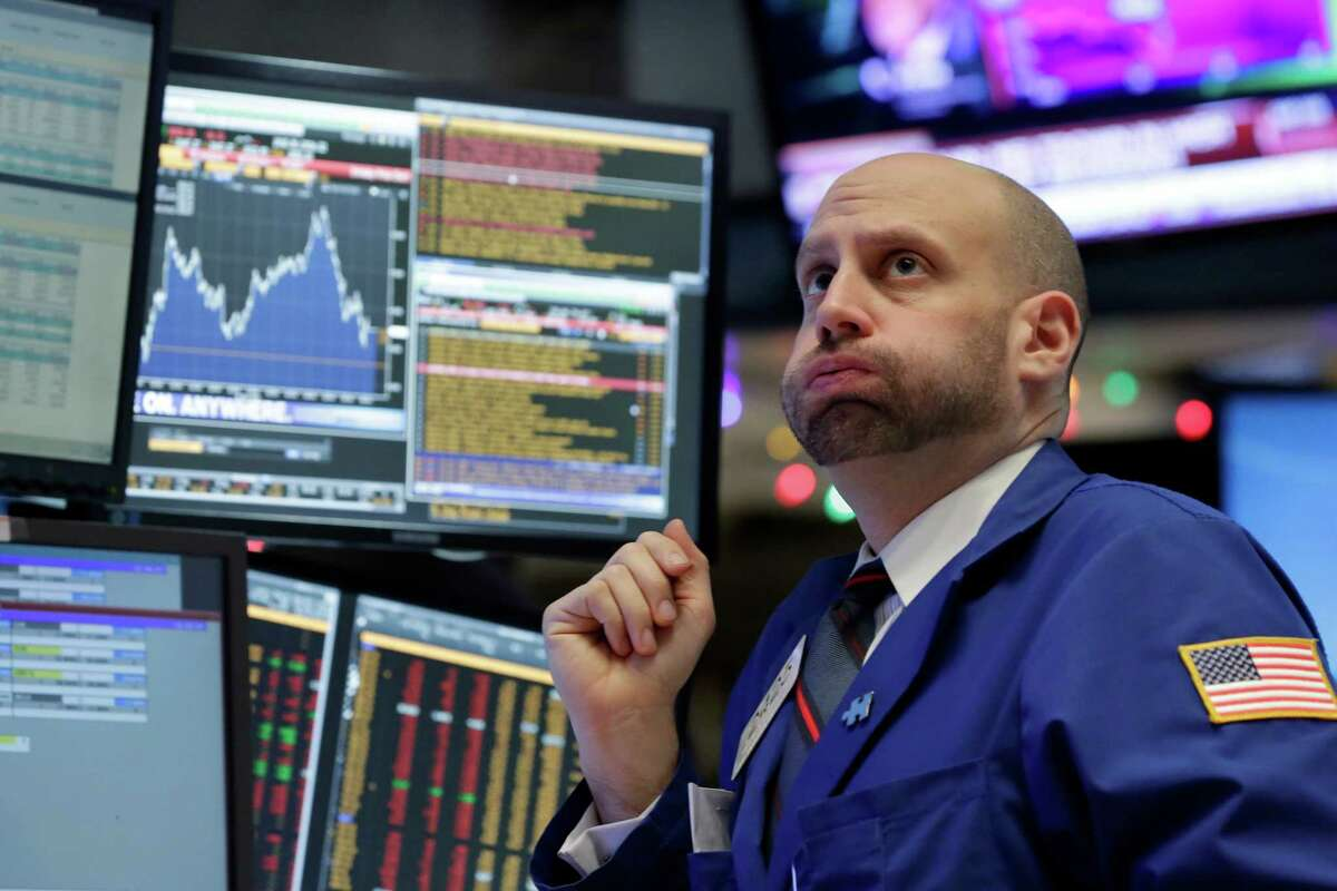Specialist Meric Greenbaum works at his post on the floor of the New York Stock Exchange, Friday, Dec. 11, 2015. Stocks are sharply lower in midday trading, led by more declines in energy and materials stocks as prices for oil and other commodities slide. (AP Photo/Richard Drew) ORG XMIT: NYRD106