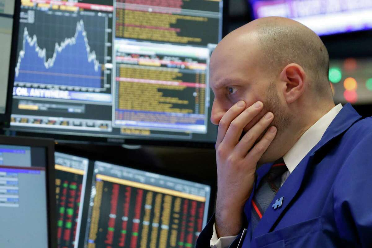 Specialist Meric Greenbaum works at his post on the floor of the New York Stock Exchange, Friday, Dec. 11, 2015. Stocks are sharply lower in midday trading, led by more declines in energy and materials stocks as prices for oil and other commodities slide. (AP Photo/Richard Drew)) ORG XMIT: NYRD107