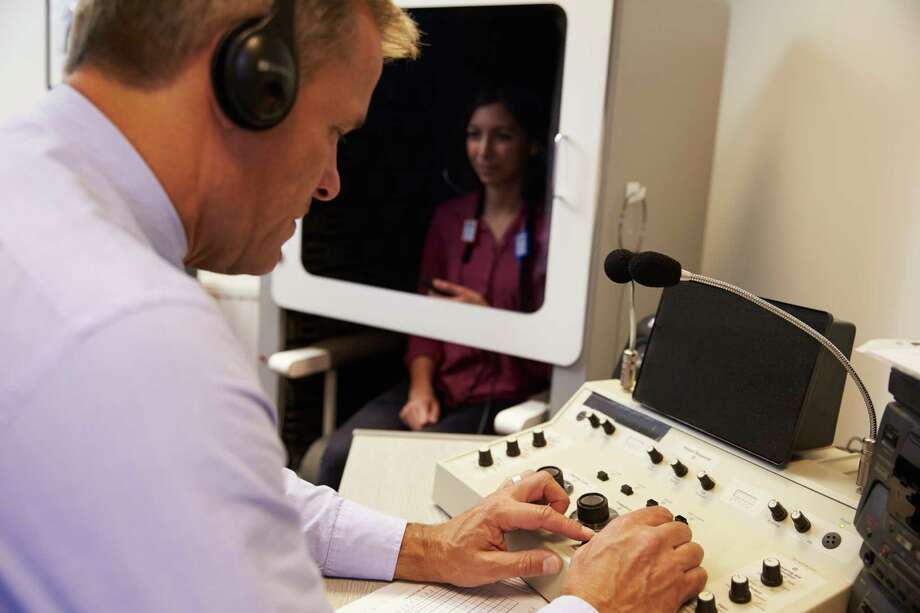 Audiologists are trained to diagnose, manage and treat hearing or balance problems for individuals from birth through adulthood. / iStockphoto