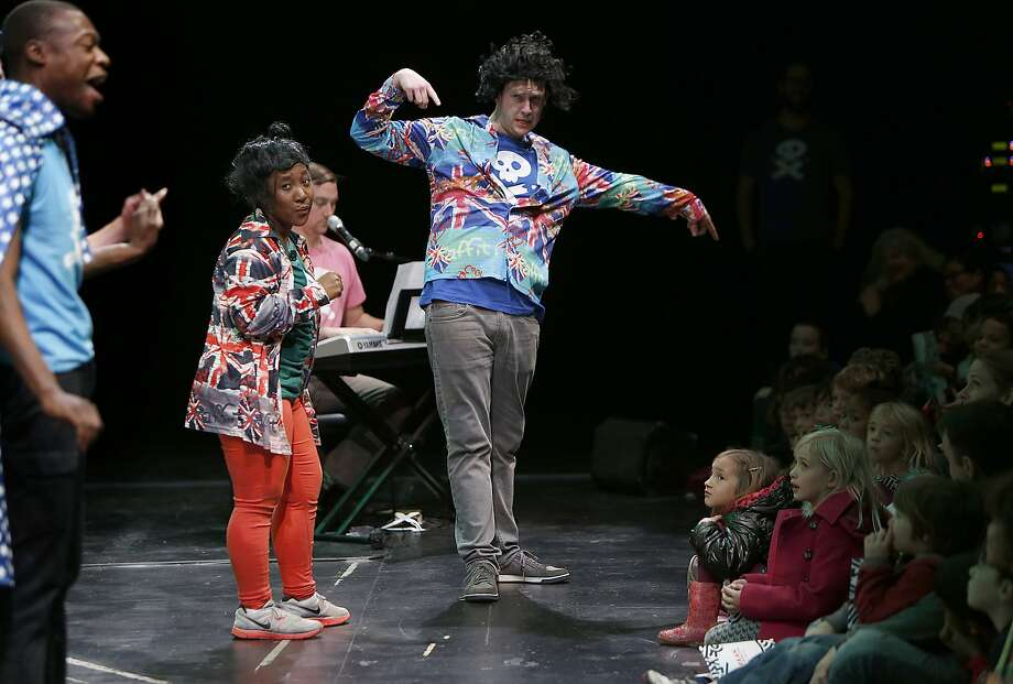 Story Pirates actors Jojo Nwoko (far left), Lindsey Ford (wearing red), and Connor White (middle) with Sunnyside Elementary School students on stage at the Curran theater in San Francisco, California, on Friday, December 11, 2015. Photo: Liz Hafalia, The Chronicle