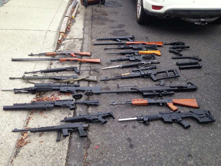 In this photo released by the California Department of Alcoholic Beverage Control, more than 40 illegal and unregistered firearms were taken from a residence following the arrest of 53 year-old Sterling Hartwell Albert of Martinez. The action was taken after ABC seized two illegal stills at a storefront in Concord along with more than 200 gallons of illegal distilled spirits and over 500 cases of illegally produced wine. Photo: California Department Of Alcoholic Beverage Control  / ONLINE_YES