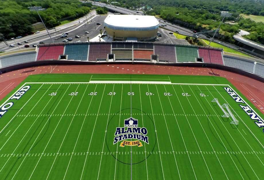 San Antonio ISD's newly-remodeled Alamo Stadium is seen Aug. 12, 2014 from a quadcopter. The Alamo Convocation Center is seen in the background Photo: William Luther /San Antonio Express-News / © 2014 San Antonio Express-News
