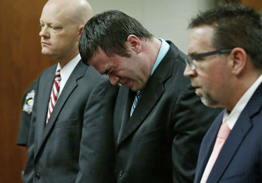Daniel Holtzclaw, flanked by defense attorneys Robert Gray (left) and Scott Adams, cries as he stands in front of the judge Thursday after the verdicts were read in his trial in Oklahoma City. Holtzclaw was found guilty of sex crimes against eight women. Jurors recommended 263 years. Photo: Sue Ogrocki / Associated Press / POOL AP