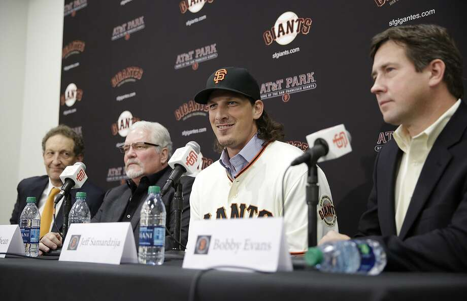 San Francisco Giants pitcher Jeff Samardzija, second from right, answers questions during a news conference Friday, Dec. 11, 2015, in San Francisco. From left to right, team president and CEO Larry Baer, executive vice president Brian Sabean and general manager Bobby Evans look on. The Giants introduced right-hander Samardzija, who signed a $90 million, five-year deal. (AP Photo/Eric Risberg) Photo: Eric Risberg, Associated Press