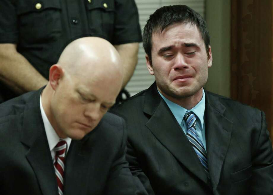 Daniel Holtzclaw, right, cries as the verdicts are read in his trial in Oklahoma City, Thursday, Dec. 10, 2015. At left is defense attorney Robert Gray. Holtzclaw, a former Oklahoma City police officer, was facing dozens of charges alleging he sexually assaulted 13 women while on duty. Holtzclaw was found guilty on a number of counts. (AP Photo/Sue Ogrocki, Pool) Photo: Sue Ogrocki, POOL / POOL AP
