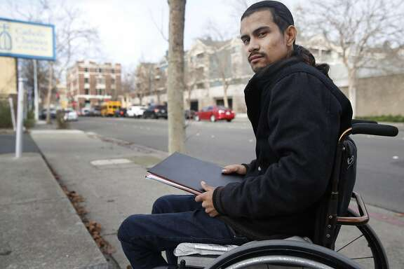Javier Arango is seen in Richmond, Calif. on Friday, Dec. 11, 2015. Arango, who was paralyzed in a drive-by shooting incident in 2006, is now a youth counselor and mentor for Catholic Charities of the East Bay.