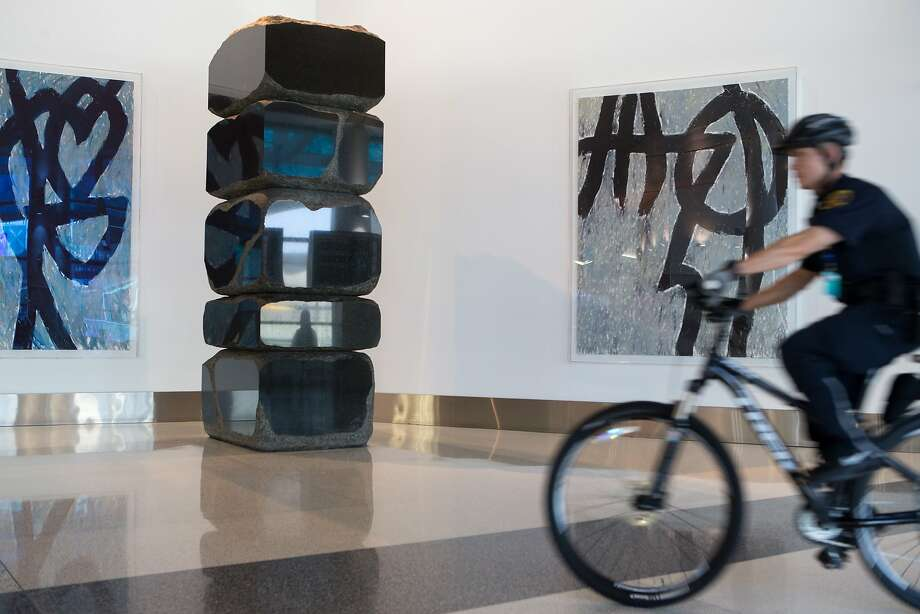 Airport security bikes pass an installation by artists Seiji Kunishima and Marc Katano. Photo: Nathaniel Y. Downes, The Chronicle
