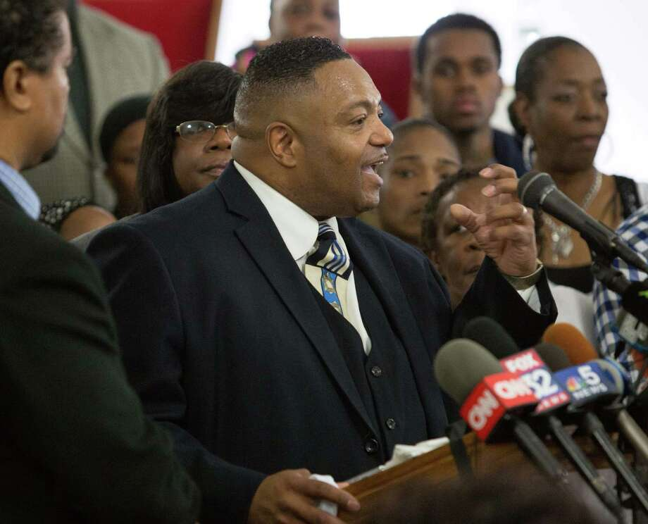 Rev. Marvin Hunter, the great uncle of Laquan McDonald, accompanied by other family members and supporters on Friday at a news conference. Photo: Teresa Crawford, STF / AP