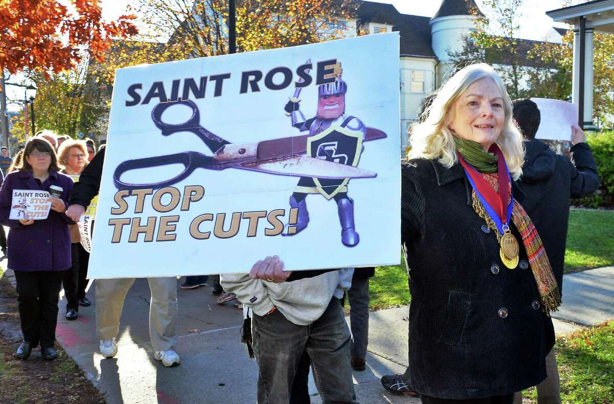 Dr. Hollis Seamon, a St. Rose English professor with 30 years service, joins students, alumni and faculty members to rally in response to proposed cuts to academics and faculty layoffs outside the Saint Rose Administration Building on Madison Ave. Friday Nov. 20, 2015 in Albany, NY. (John Carl D'Annibale / Times Union)