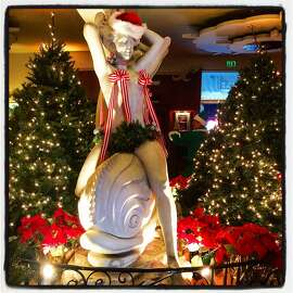 Floral designer Claire Marie Johnston adorned Bimbo's 365 interior with holiday decor. Dec 2015.