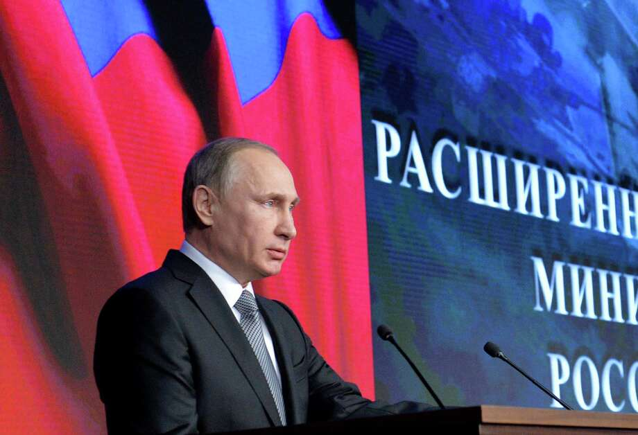 Russian President Vladimir Putin delivers his speech during a meeting with top military officials in Moscow, Russia, Friday, Dec. 11, 2015. Putin said the Russian military action helped change the situation in Syria, supporting the Syrian army offensive. (Alexei Druzhinin/Sputnik, Kremlin Pool Photo via AP) Photo: Alexei Druzhinin, POOL / POOL SPUTNIK KREMLIN