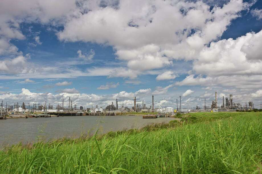Several production plants rise above the coastal plain at Dow Chemical Co's. petrochemical complex in near Freeport in Brazoria County. A proposed merger with DuPont would create a chemical colossus that then would spin petrochemical operations into one of three new publicly traded entities. (Dow Chemical photo)