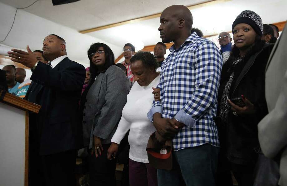 "The Rev. Marvin Hunter (left), Laquan McDonald's great-uncle, said: ""What we're feeling in Chicago is the real feeling of America itself, and that's injustice against people of color,"" during a news conference. Photo: Abel Uribe /Tribune News Service / Chicago Tribune"
