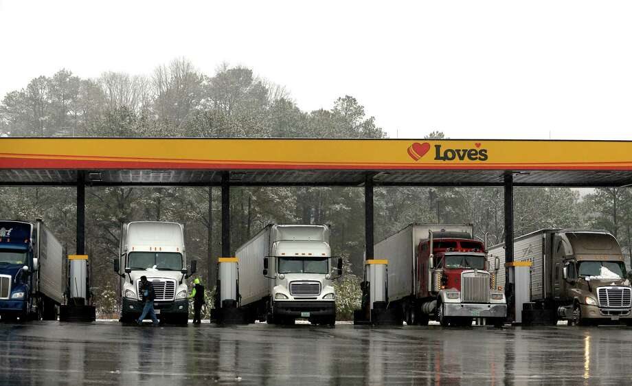 Truckers fuel up in Emerson, Ga. A new government rule requires commercial truck and bus drivers to electronically record their hours behind the wheel in an effort to enforce regulations to prevent fatigue.  Photo: David Tulis, FRE / FR170493 AP