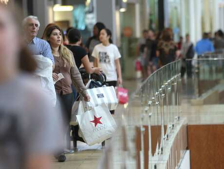 Shoppers walk the hallways of the Galleria