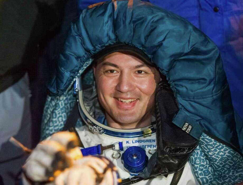 International Space Station crew member U.S. space agency's Kjell Lindgren smiles after landing near the town of Dzhezkazgan, Kazakhstan, Friday, Dec. 11, 2015. A three-person crew, U.S. space agency's Kjell Lindgren, Russia's Oleg Kononenko and Kimiya Yui of Japan, from the International Space Station landed safely Friday in the snowy steppes of Kazakhstan. (Andrey Shelepin/Pool Photo via AP) Photo: Andrey Shelepin, POOL / POOL REUTERS