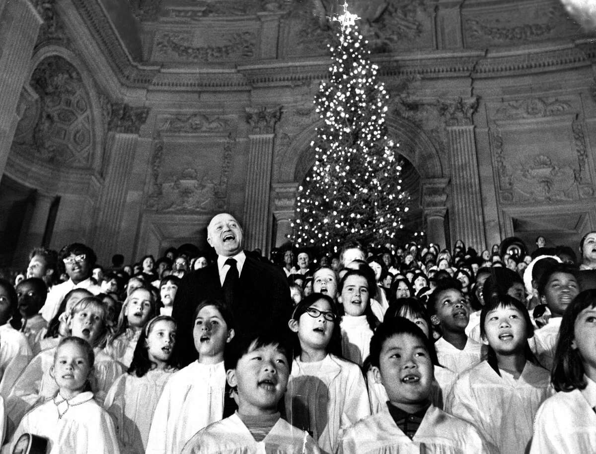 """Mayor Joe Alioto sings """"We Wish You a Merry Christmas"""" with the Rec-Parks Children's Chorus at City Hall in 1970."""