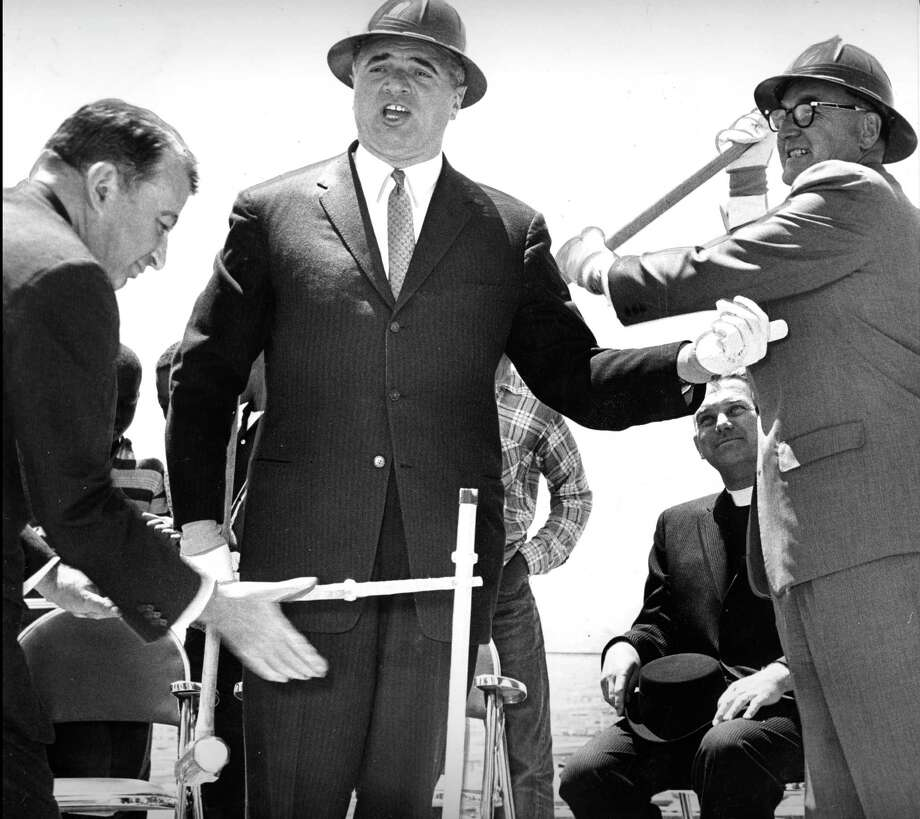 Governor Edmund G. Brown jokingly takes a swing at Mayor George Christopher (c)  while Joseph Eichler (l) holds the drill in February, 1949. Photo: Peter Breinig / The Chronicle / ONLINE_YES