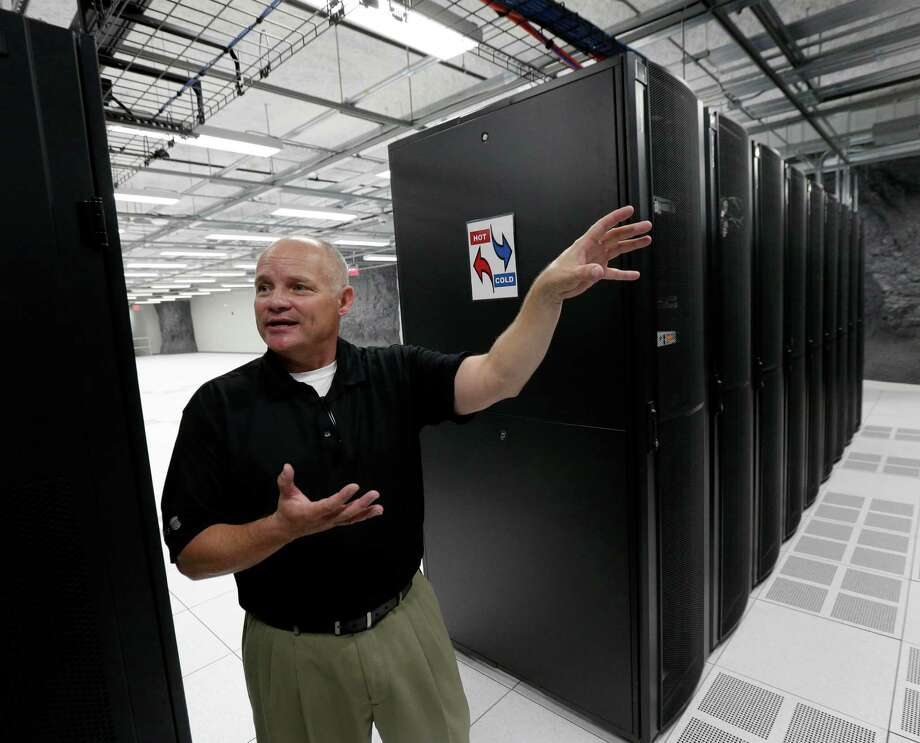 In this photo taken Tuesday, July 14, 2015, Bob Perkins, facilities manager at LightEdge Data Center, talks about the company's new data storage facility in Kansas City, Mo. LightEdge Solutions Inc. opened with the help of a projected $15.5 million in sales, income and property tax breaks. An Associated Press analysis of state revenue and economic-development records shows that government officials extended nearly $1.5 billion in tax incentives to hundreds of data-center projects nationwide during the past decade. (AP Photo/Charlie Riedel) Photo: Charlie Riedel, STF / Associated Press / AP