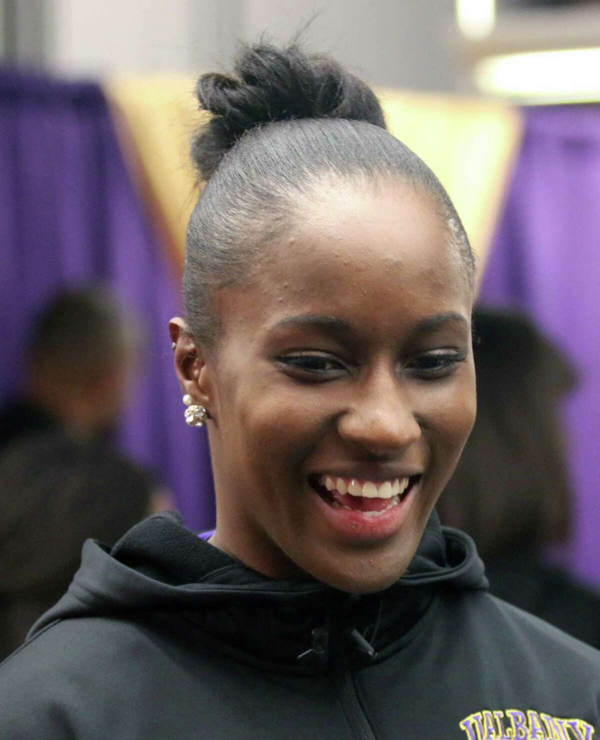 UAlbany's Shereesha Richards seems pleased to hear the Danes will be facing Duke during Monday's watch party at UAlbany for the NCAA Women's Basketball Tournament selection show. (Ed Burke / Special to the Times Union)