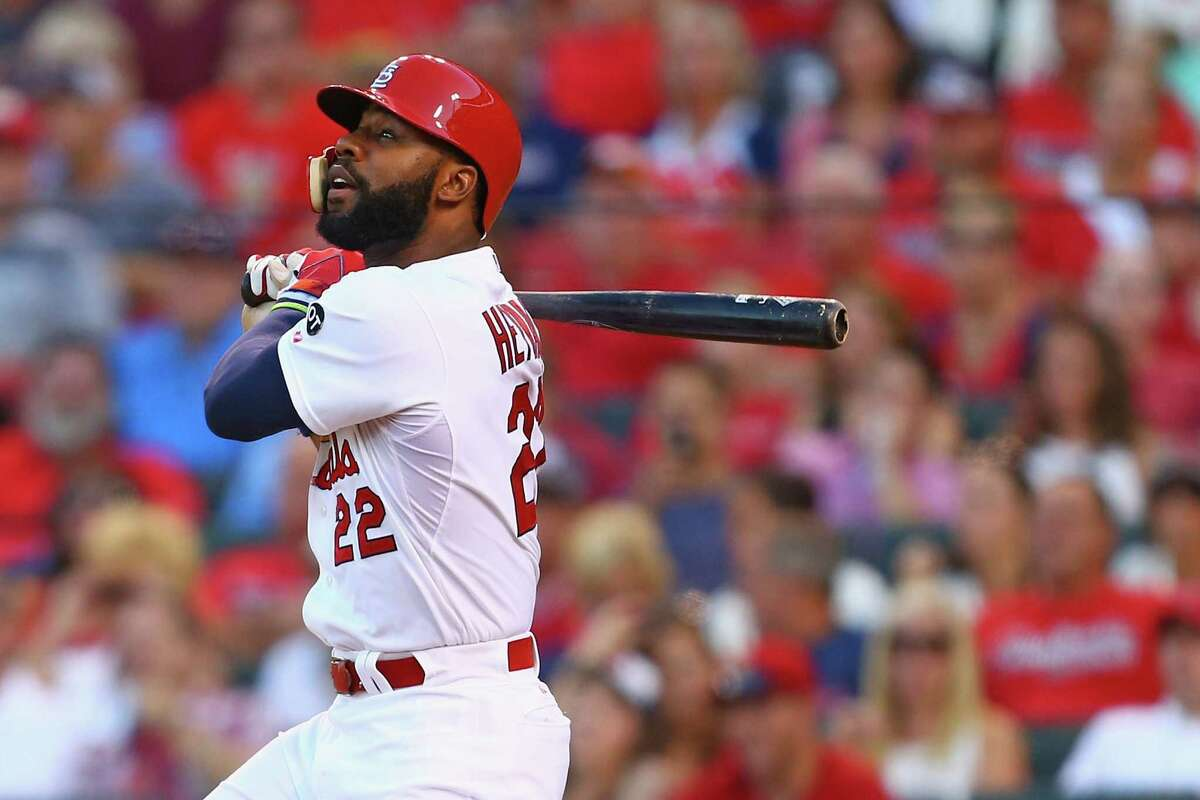 ST. LOUIS, MO - JULY 31: Jason Heyward #22 of the St. Louis Cardinals hits a sacrifice RBI against the Colorado Rockies in the first inning at Busch Stadium on July 31, 2015 in St. Louis, Missouri. (Photo by Dilip Vishwanat/Getty Images) ORG XMIT: 538587799