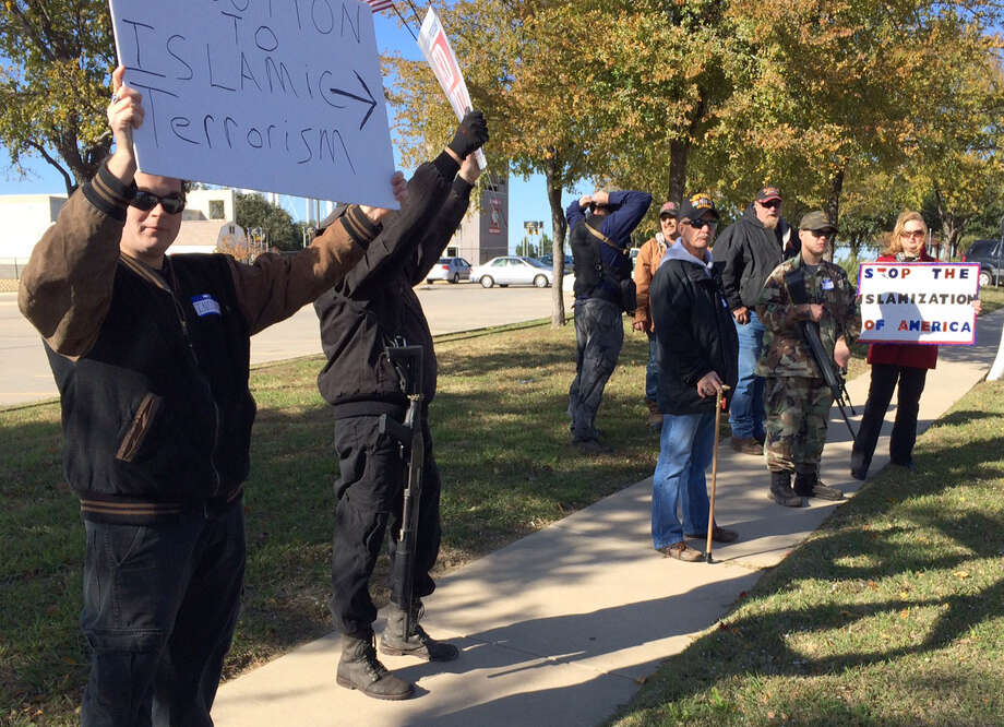 "Armed demonstrators known as ""Three Percenters"" protest outside the Islamic Center of Irving in October. Another demonstration is set for today. Photo: Avi Selk, MBR / The Dallas Morning News"