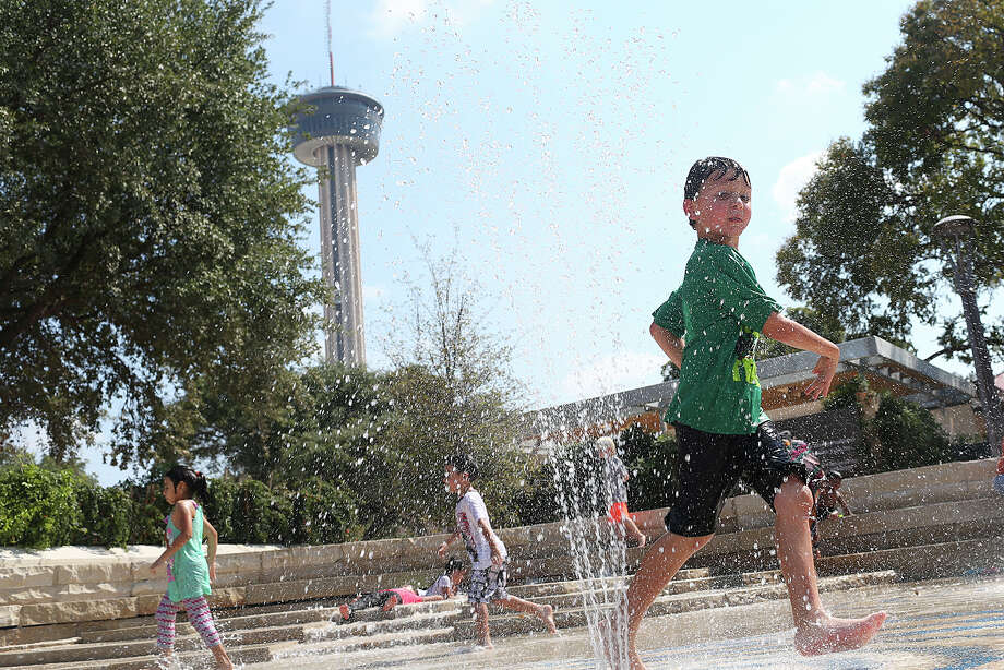 Max Villon, 6, plays in the water features at the Yanaguana Gardens in Hemisfair Park, Sunday, Oct. 11, 2015. Temperatures hit the low 90Õs and lows were expected in the 70Õs during the nighttime. Conditions are expected to remain the same through most of this week according to the National Weather Service. Photo: JERRY LARA, Staff / San Antonio Express-News / © 2015 San Antonio Express-News