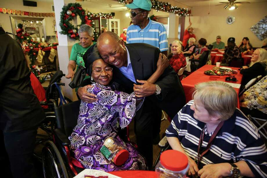 Sylvester Turner is embraced by Agatha Muokebe during a visit Friday to Oak Shadows Retirement and Assisted Living Community. His campaign is focusing on a boots-on-the-ground strategy. Photo: Michael Ciaglo, Staff / © 2015  Houston Chronicle