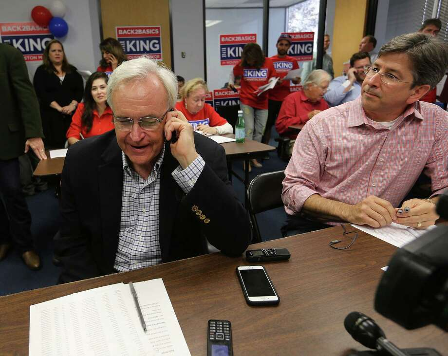 Bill King chats Friday on the phone of volunteer Anthony Etheridge at a calling center. His campaign is planning to use telephone calls to drive supporters to the polls Saturday. Photo: Elizabeth Conley, Staff / © 2015 Houston Chronicle