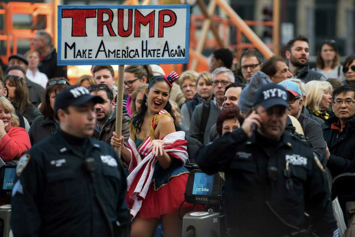 Protesters on Friday rally outside the Plaza Hotel in New York, where Donald Trump spoke at a luncheon. Though Trump mocks his opponents as low energy, his own campaign travel schedule is relatively sleepy.