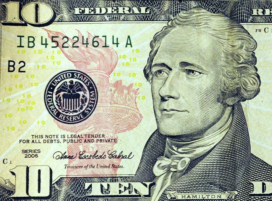 (FILES): This March 29, 2009 file illustration shows Alexander Hamilton, the first US Secretary of the Treasury,  on the front of the USD10 note in Washington, DC.  US Treasury Secretary Jacob J. Lew announced June 17, 2015 that a newly redesigned USD10 note will replace the image of Hamilton and  feature a woman.  In exercising his responsibility to select currency features and design, Treasury Secretary Lew will select a notable woman  with a focus on celebrating a champion for America's inclusive democracy.  The Treasury Department, with the Bureau of Engraving and Printing (BEP), expects to unveil the new USD10 note in 2020, the 100th anniversary of the passage of the 19th Amendment, which gave women the right to vote.  Historically, the Secretary has relied on the Bureau of Engraving and Printing to provide advice on themes, symbols and concepts to be used on currency.  However, for the newly redesigned note, the Secretary is seeking input from the public about what qualities best represent democracy to help guide the design process for the next generation of notes. AFP PHOTO / Files / Karen BLEIERKAREN BLEIER/AFP/Getty Images Photo: KAREN BLEIER, Staff / AFP