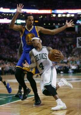 Boston Celtics' Isaiah Thomas drives against Golden State Warriors' Shaun Livingston during Warriors 124-119 double overtime win in NBA game at TD Garden in Boston, Massachusetts on Friday, December 11, 2015.
