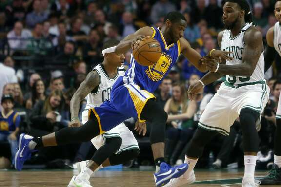 Golden State Warriors' Ian Clark dribbles against Boston Celtics' Jar Crowder in 3rd quarter during Warriors 124-119 double overtime win in NBA game at TD Garden in Boston, Massachusetts on Friday, December 11, 2015.