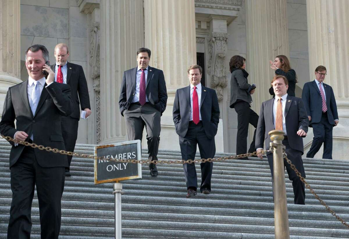 Members of the House of Representatives leave Capitol Hill in Washington, Friday, Dec. 11, 2015, after a voice vote to approve a short-term spending bill to keep the government open and avoid a crisis when the current budget expires at midnight. Today's vote extends that deadline through Wednesday, Dec. 16, 2015, to allow more time for talks as lawmakers and the White House rush to finalize a $1.1 trillion government-wide spending bill and a sprawling tax package. (AP Photo/J. Scott Applewhite) ORG XMIT: DCSA107