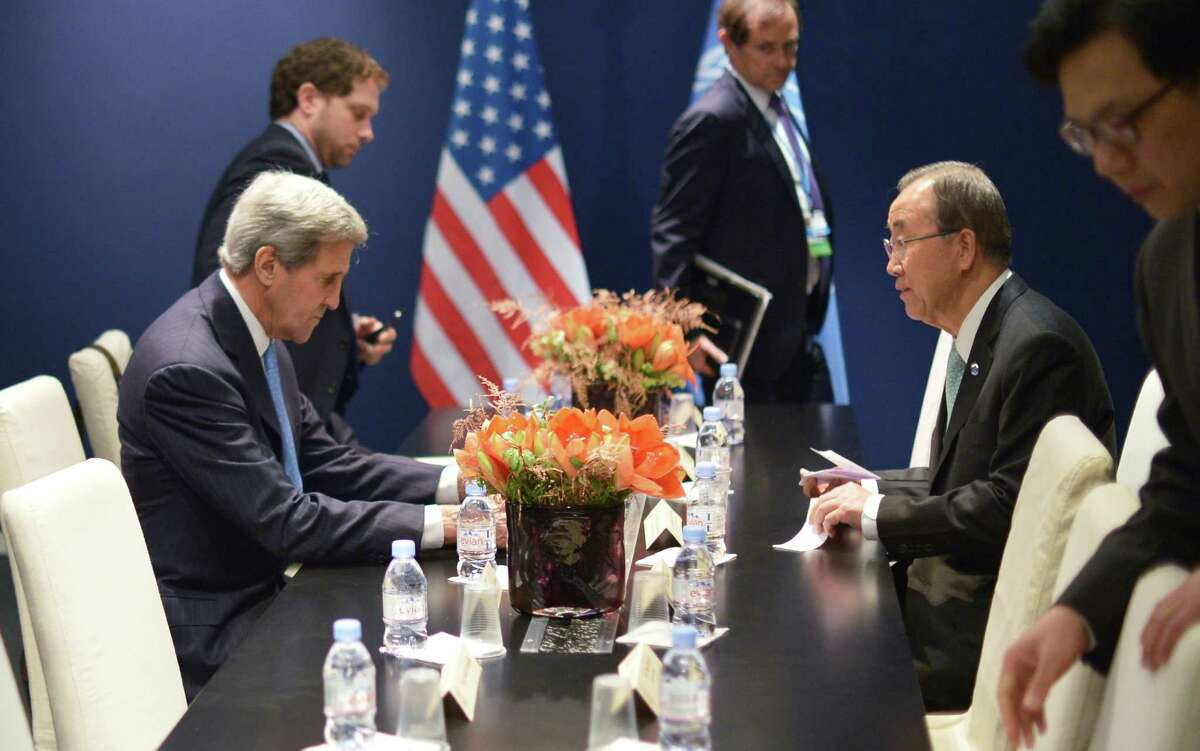 US Secretary of State John Kerry, left, and United Nations Secretary General Ban Ki-moon meet on the sidelines of the COP 21 United Nations conference on climate change, in Le Bourget, on the outskirts of Paris on Friday Dec. 11, 2015. (Mandel Ngan, Pool via AP) ORG XMIT: LON119