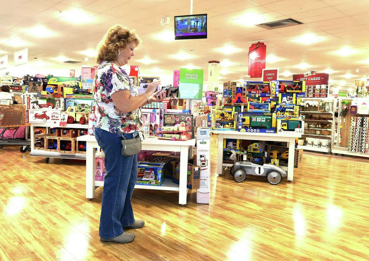 Linda Matuszak holds her ever present smart phone with the Shopkick app on board at Wilton Mall Friday Dec. 11, 2015 in Wilton, N.Y. (Skip Dickstein/Times Union)