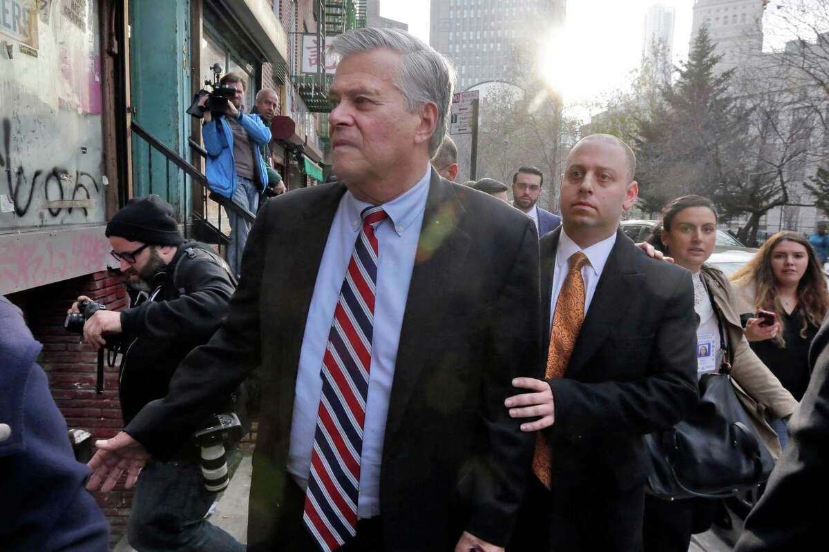 Former New York state Senate leader Dean Skelos, left, and his son Adam Skelos leave federal court, Friday, Dec. 11, 2015, in New York. Skelos and his son were convicted Friday of federal extortion charges, marking the second time in a month that one of Albany's most powerful politicians was run out office following a case that put the state capital's political culture on trial. (AP Photo/Richard Drew) ORG XMIT: NYRD111