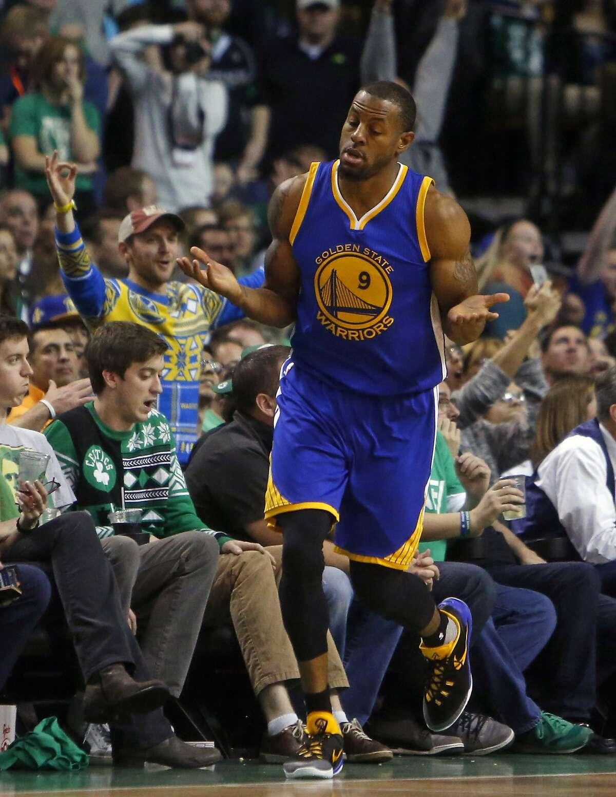 Golden State Warriors' Andre Iguodala celebrtes 3-pointer in 1st overtime of Warriors 124-119 double overtime win over Boston Celtics in NBA game at TD Garden in Boston, Massachusetts on Friday, December 11, 2015.