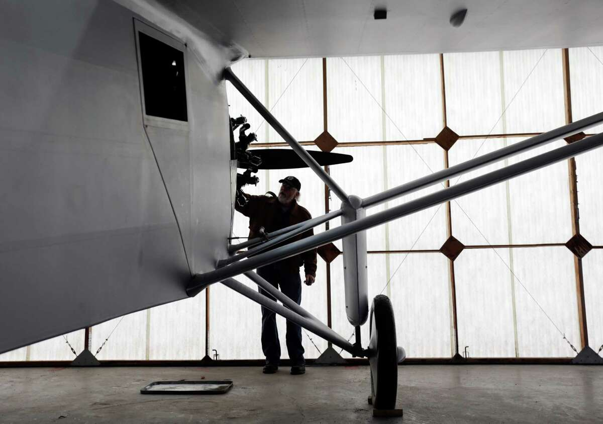 In this Sunday, Dec. 6, 2015 photo, pilot Ken Cassens readies a Spirit of St. Louis replica for flight at the Old Rhinebeck Aerodrome in Rhinebeck, N.Y. Cassens has spent years creating a doppelganger of the plane Charles Lindbergh flew across the Atlantic in 1927 down to every flap and fuel gauge. (AP Photo/Mike Groll) ORG XMIT: NYMG301