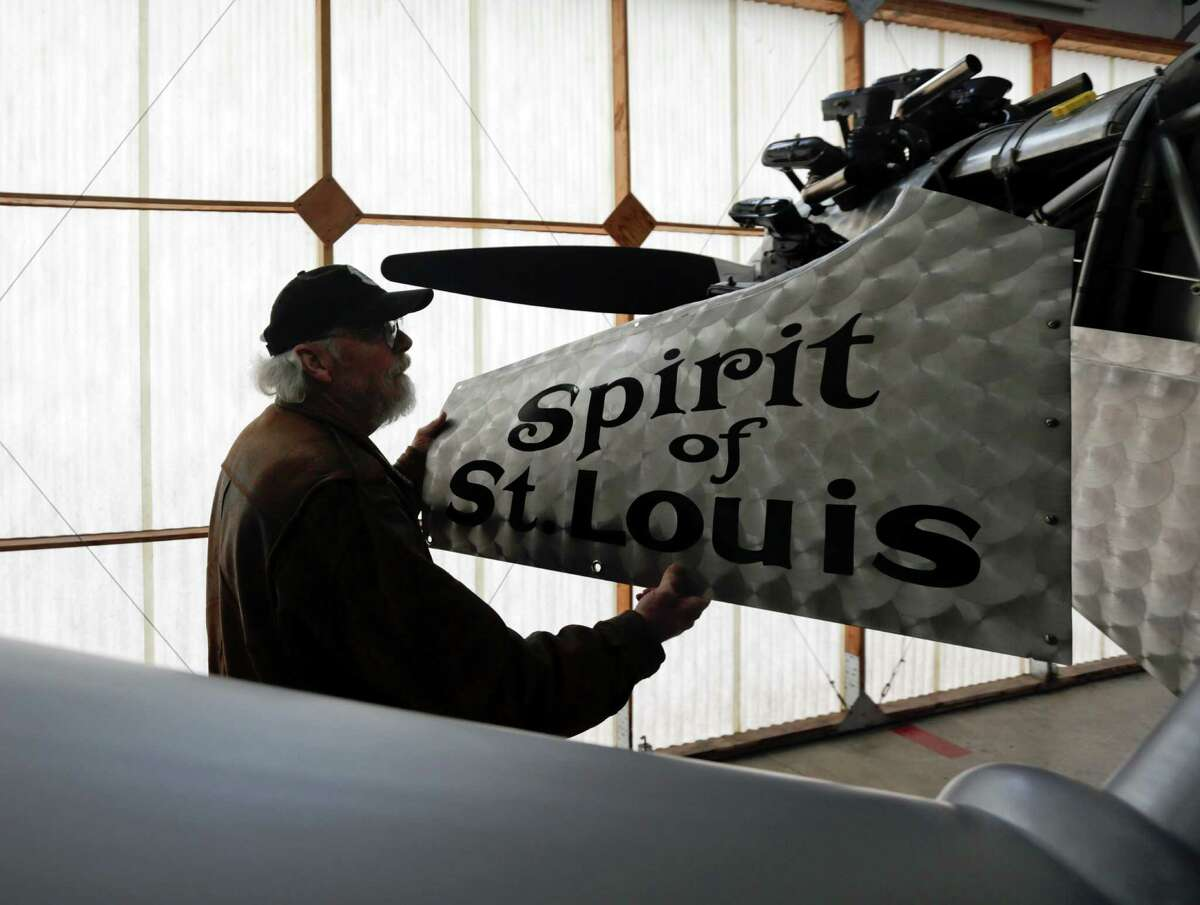 In this Sunday, Dec. 6, 2015 photo, pilot Ken Cassens readies a Spirit of St. Louis replica for flight at the Old Rhinebeck Aerodrome in Rhinebeck, N.Y. Cassens has spent years creating a doppelganger of the plane Charles Lindbergh flew across the Atlantic in 1927 down to every flap and fuel gauge. (AP Photo/Mike Groll) ORG XMIT: NYMG302