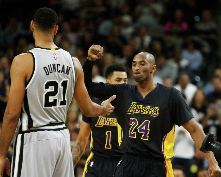SAN ANTONIO, TX - DECEMBER 11: Kobe Bryant #24 of the Los Angeles Lakers greets Tim Duncan #21 of the San Antonio Spurs before the game at AT&T Center on December 11, 2015 in San Antonio,Texas. NOTE TO USER: User expressly acknowledges and agrees that, by downloading and/or using this Photograph, user is consenting to the terms and conditions of the Getty Images License Agreement. Photo: Ronald Cortes, Getty Images / 2015 Getty Images