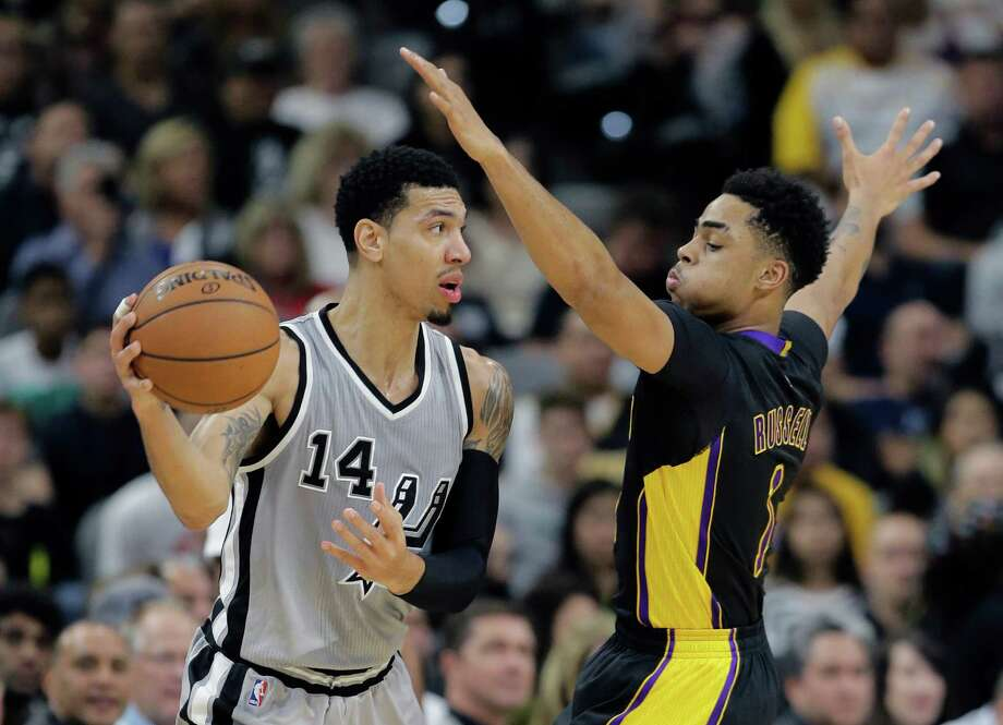 San Antonio Spurs guard Danny Green (14) is defended by Los Angeles Lakers guard D'Angelo Russell (1) during the first half of an NBA basketball game, Friday, Dec. 11, 2015, in San Antonio. (AP Photo/Eric Gay) Photo: Eric Gay, Associated Press / AP